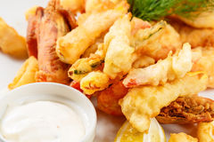 Breaded Prawns - King prawns coated in plain and spicy breadcrumbs and deep-fried. On white plate with full serving Stock Images