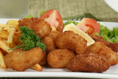 Breaded scampi and chips royalty free stock photo