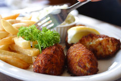 Breaded scampi tails with salad leaves Stock Photo