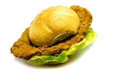 Breaded schnitzel in bun with salad isolated on white background royalty free stock photo