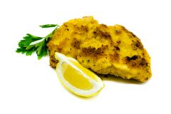 Breaded schnitzel with lemon isolated on white background stock photography