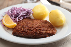 Breaded schnitzel with potato Royalty Free Stock Photo