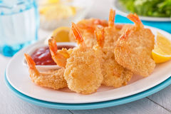 Breaded Shrimp. Delicious breaded deep fried shrimp on a rustic table Stock Images