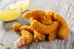 Breaded shrimp. With lemon gold Royalty Free Stock Photos