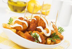 Breaded shrimp snack with french fries Stock Image