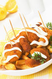 Breaded shrimp snack with french fries Royalty Free Stock Photos