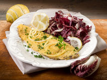 Breaded sole with chicory salad Stock Photo