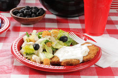 Breaded steak and salad Royalty Free Stock Photography