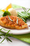 Breaded turbot fillet with green beans Royalty Free Stock Photography
