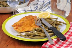 Breaded veal cutlet with green beans royalty free stock photo