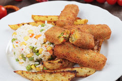 Breaded veggie sticks. With roasted potato and rice Royalty Free Stock Image