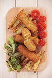 Breaded veggie sticks. With roasted potato and salad Royalty Free Stock Photography