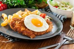 Free Breaded Viennese Schnitzel With Fried Agg Royalty Free Stock Image - 109315466