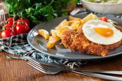 Free Breaded Viennese Schnitzel With Fried Agg Stock Images - 118684464