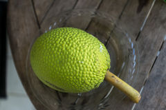 Breadfruit. Beautiful textures of breadfruit on a plate on a wooden table Stock Photo