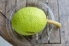 Breadfruit. Beautiful textures of breadfruit on a plate on a wooden table Royalty Free Stock Image