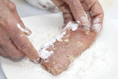Breading a cordon bleu - adding flour Royalty Free Stock Image