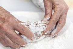 Breading a cordon bleu - adding flour Stock Image