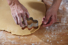 Breadman cutter. Chef cutting the ginger breadman from the dough Royalty Free Stock Image