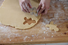 Breadman cutter. Chef cutting the ginger breadman from the dough Royalty Free Stock Images