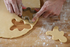 Breadman cutter. Chef cutting the ginger breadman from the dough Stock Photography