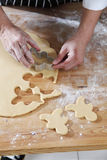 Breadman cutter. Chef cutting the ginger breadman from the dough Stock Photo