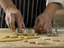 Breadman cutter. Chef cutting the ginger breadman from the dough Royalty Free Stock Photo