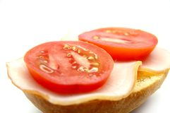Breadroll with ham and tomato Royalty Free Stock Photos