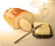 Breadroll and milk Stock Image