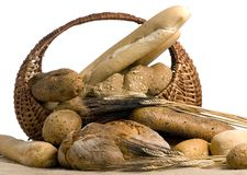 Breads 12-10. An assortment of fresh breads in a basket isolated on a white background Royalty Free Stock Photo