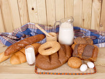 Breads. On wood background Stock Image