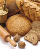 Breads. Group of breads, pestle and mortar on the white table.Visit my portfolio for other bakery products image Royalty Free Stock Images