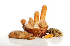 Breads in basket. Accompanied by wheat and corn seed Stock Image