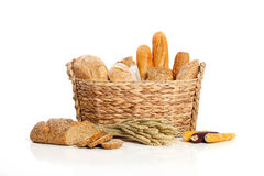 Breads in basket 2. Breads in basket accompanied by wheat and corn seed Stock Image