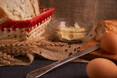 Breads and butter concept of teasty home food close up on table stock images