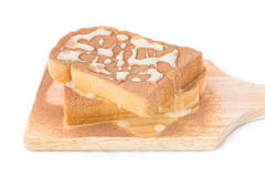 Breads with chocolate powder on top. Spreading chocolate power and sweet milk on breads royalty free stock photo