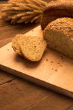 Breads on chopping board. Bread on chopping board and rustic tabletop background Stock Image