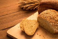 Breads on chopping board. Bread on chopping board and rustic tabletop background Stock Photography