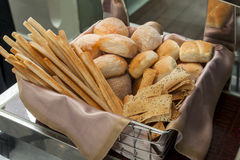 Breads and crispy sticks in stainless basket. Royalty Free Stock Photo