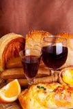 Breads and cups of wine Royalty Free Stock Image