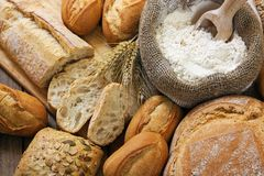 Breads. Different breads on wood background Stock Photo