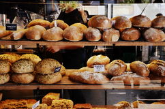 Breads on display in a bakery. Various breads being displayed in a bakery inside the market of Torvehallerne, in Copenhagen, Denmark Stock Photos