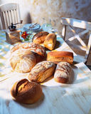 Breads on the kitchen table Royalty Free Stock Images