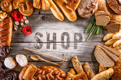 Breads, pastries, christmas cake on wooden background with letters, picture for bakery or shop Royalty Free Stock Photos