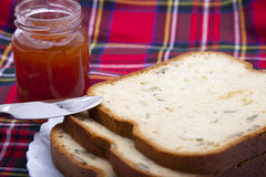 Breads with strawberry jam Stock Images