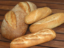 Breads and rolls. A close up view of several different kinds of fresh baked breads and rolls stock photos