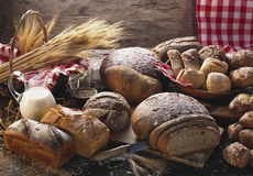 Breads & rolls. Various breads & rolls, decoration, ears of corn & milk Stock Photos