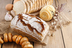 Breads and rolls on rustic wooden table Stock Photo