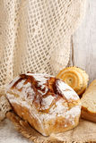 Breads and rolls on wooden table Royalty Free Stock Photography