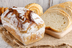 Breads and rolls on wooden table Stock Photos